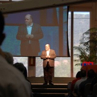 Dean Speaks – Center aisle with video simulcast